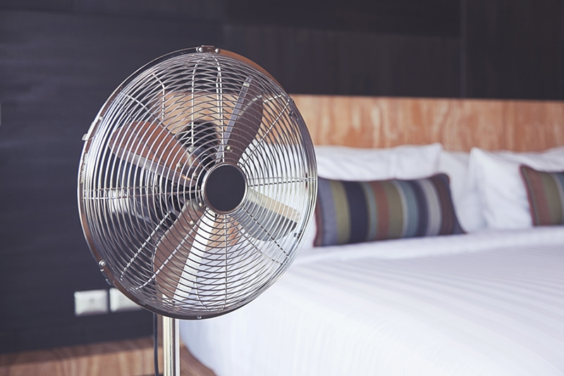 electric fan in a bedroom, improve your home's indoor air quality